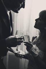 Happy couple toasting - black and white image