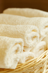 close-up basket of pure white towels