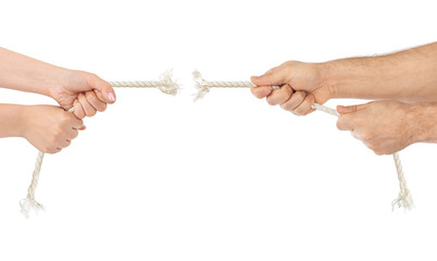 Man and woman hands with breaking rope