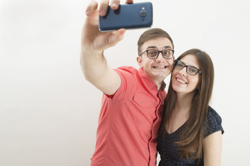 Young couple taking a selfie with a cell phone