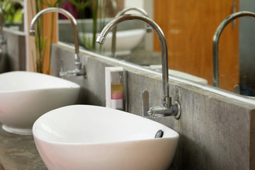 Faucetc and white sinks