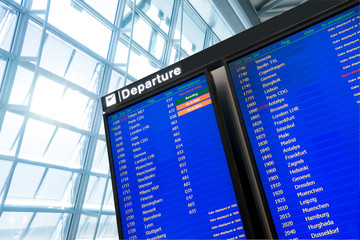 Fotomurales - Flight information, arrival and departure board at the airport
