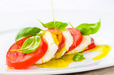 Mozzarella and tomatoes, caprese salad.
