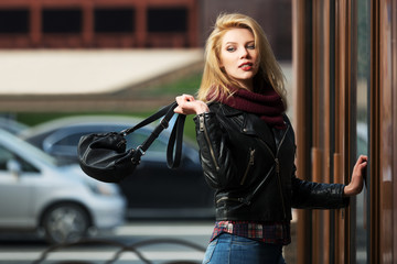 Young fashion blond woman with handbag at the mall door Wall mural