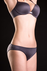 Closeup view image of slim woman`s body in lingerie