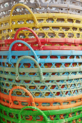 Pile of the new bamboo baskets painted in bright colors