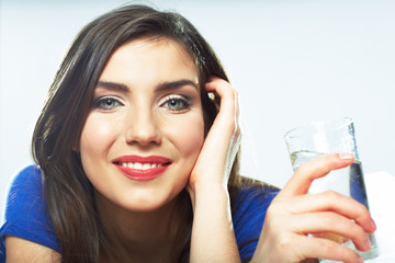 Woman holding water glass.