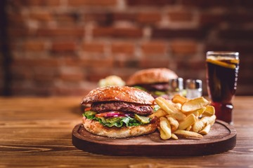 Fresh burger on wooden table.