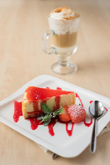Cheesecake piece with strawberry sauce and berry