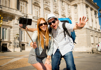 friends tourist couple on Madrid holidays taking selfie picture