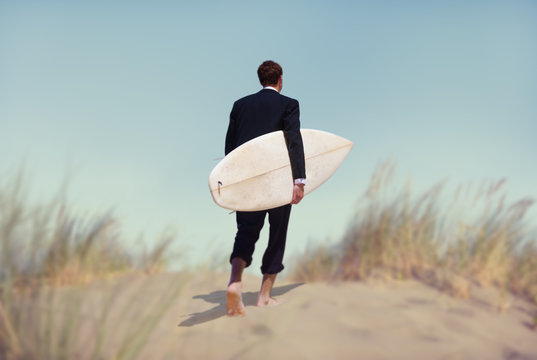 Businessman with Surfboard Going to the Beach