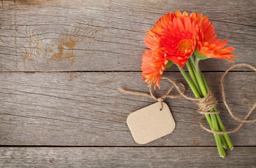 Foto auf Acrylglas Gerbera Orange gerbera flowers with tag