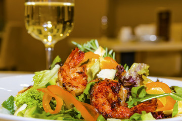 Juicy portions of grilled tiger prawns  with greens and vegetabl