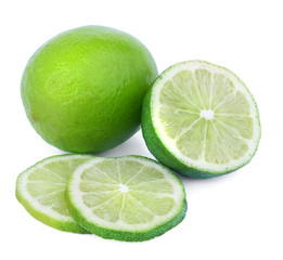 Two limes isolated on a white background