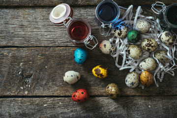 Colorful Easter eggs on wooden background with blank space