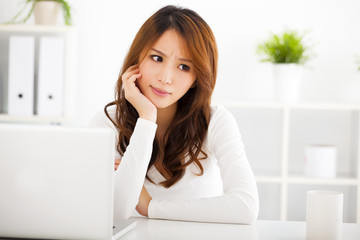 Stressed young woman with laptop