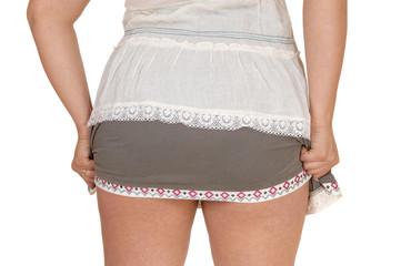 Woman's behind in skirt.