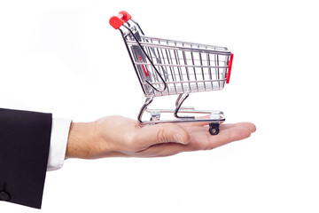 Businessman holding a shopping cart, isolated over white backgro