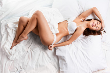 Sensual woman laying in bed