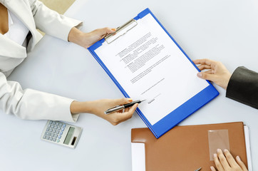 White collar worker give a contract to sign