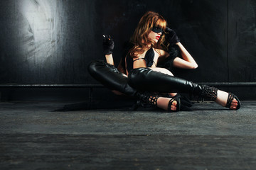 sexy woman with mask chilling on the ground