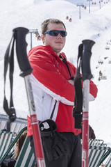 Sportsman taking a deep breath after skiing