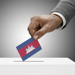 Black male holding flag. Voting concept - Cambodia
