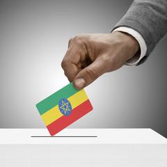 Black male holding flag. Voting concept - Ethiopia