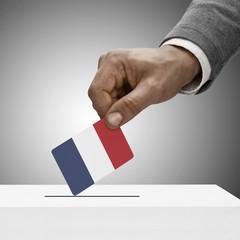 Black male holding flag. Voting concept - France