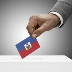 Black male holding flag. Voting concept - Haiti