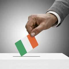 Black male holding flag. Voting concept - Ireland