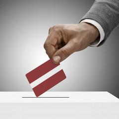 Black male holding flag. Voting concept - Latvia