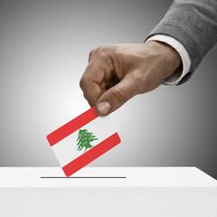 Black male holding flag. Voting concept - Lebanon