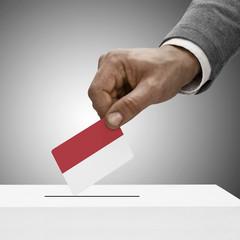 Black male holding flag. Voting concept - Monaco