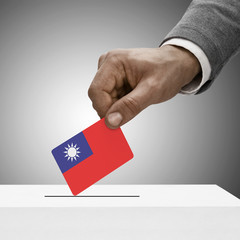 Black male holding flag. Voting concept - China - Taiwan