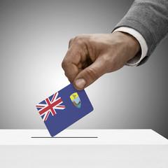 Black male holding flag. Voting concept - Saint Helena