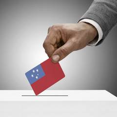 Black male holding flag. Voting concept - Samoa