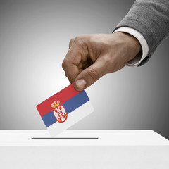 Black male holding flag. Voting concept - Serbia