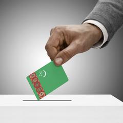 Black male holding flag. Voting concept - Turkmenistan