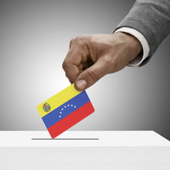 Black male holding flag. Voting concept - Venezuela