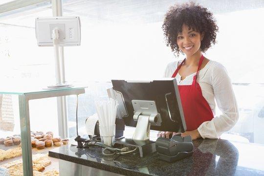 Beautiful waitress posing behind the counter