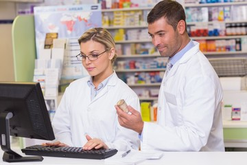 Team of pharmacists looking at the computer
