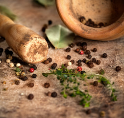 Herbs and spices with Mortar on wooden background
