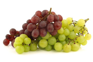 fresh red and white seedless  grapes on the vine