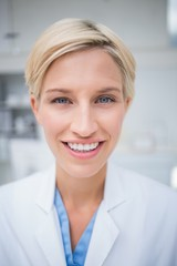 Close-up of female doctor smiling