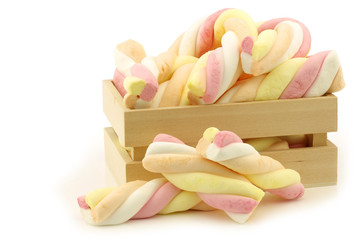 colorful marshmallow twisted sticks candy in a wooden box