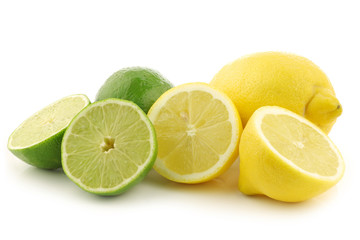 colorful fresh lime and lemon fruit and some cut ones