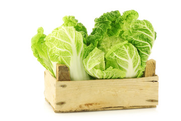 Spoed Foto op Canvas Keuken chinese cabbage in a wooden crate on a white background