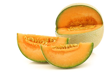 cut fresh cantaloupe melon on a white background