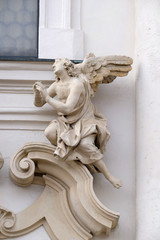 Angel on the portal of Mariahilf church in Graz, Austria